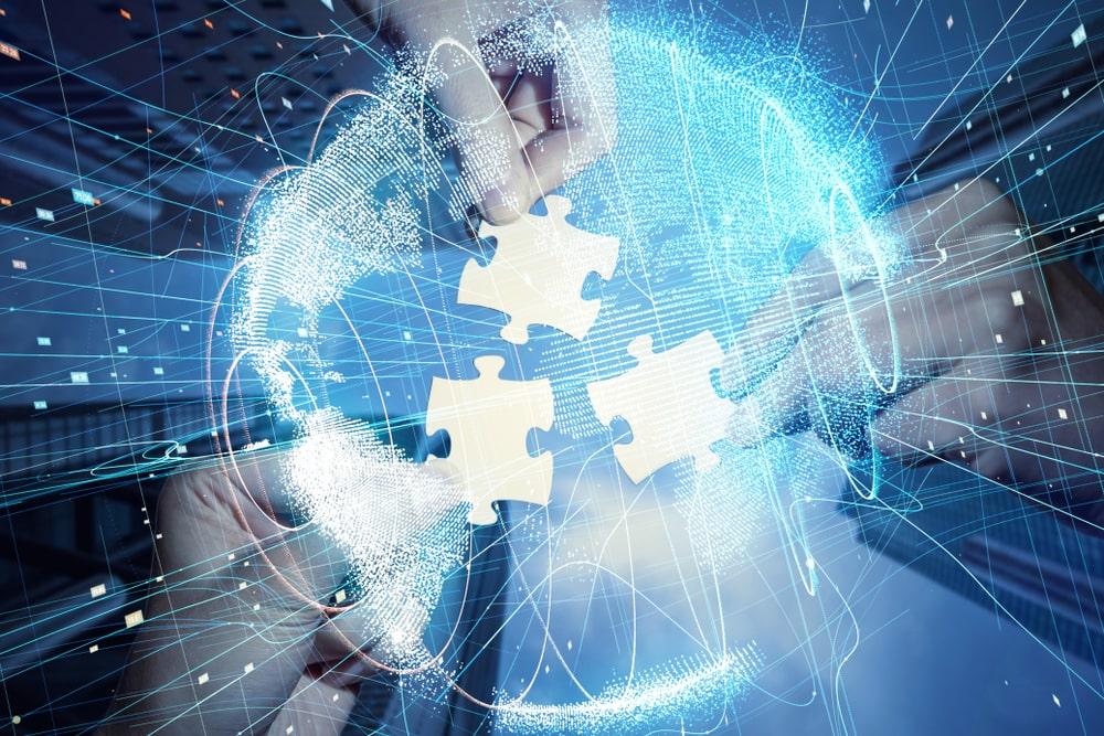 Imagem de quebra cabeça simbolizando a união de empresas (imagem ilustrativa). Texto: fusão de franquias.